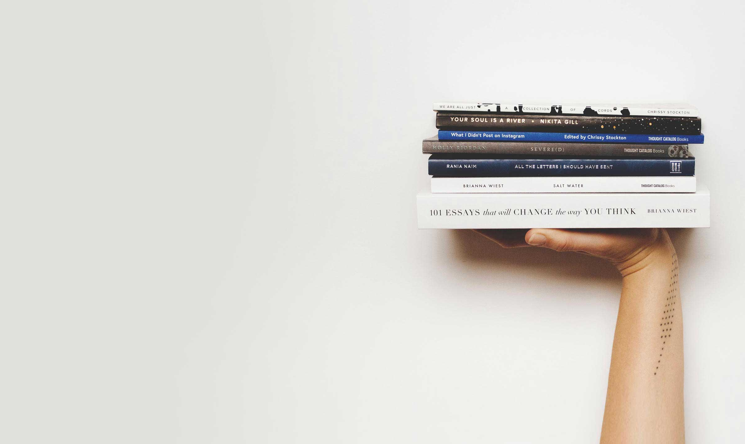 Tablo masthead holding books